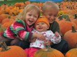 Deb (Johnson) Panter's grandchildren,Ryan, Ella, & Kate, enjoying the pumpkin patch